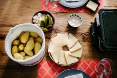 Free Swiss Traditional Dish Called Raclette Including Steamy Potatoes Royalty Free Stock Photography - 107695417
