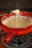 Swiss traditional fondue Stock Photo