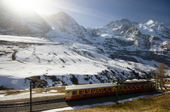 Swiss train with Alps background Royalty Free Stock Image