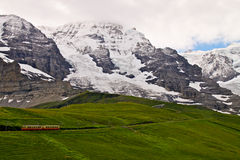 Swiss train climbing up Alps Royalty Free Stock Photography