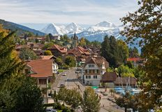 Swiss village. With snowy peaks on the background Stock Images