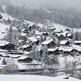 Swiss Village. View over a Swiss Village in the Alps, covered in snow during winter Stock Photography