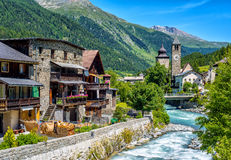 Swiss village in Alps mountains, Grisons, Switzerland. Susch village on Inn river in swiss Alps mountains in Grisons canton, Switzerland royalty free stock photo