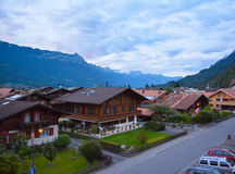 Swiss village amidst mountain Stock Photography