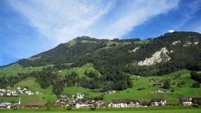 Swiss village on hillside Royalty Free Stock Photos