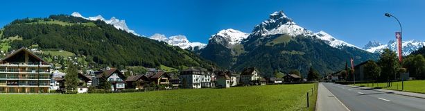 Swiss village, road and alpine mountains Royalty Free Stock Photography