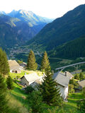 Swiss village in valley. (sunset royalty free stock photo