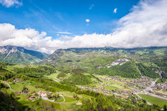 Swiss village in valley near Reichenbach. Swiss village in valley under low clouds near Reichenbach, Switzerland Stock Photography