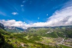 Swiss village in valley near Reichenbach. Swiss village in valley under low clouds near Reichenbach, Switzerland Stock Photos