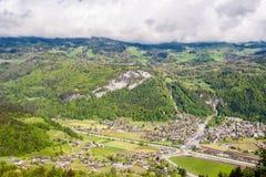 Swiss village in valley near Reichenbach. Swiss village in valley under low clouds near Reichenbach, Switzerland Royalty Free Stock Photos