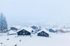 Swiss Village in Winter with Tilt-Shift Effect Royalty Free Stock Photos