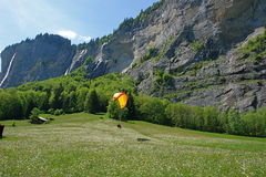 Swiss waterfall, paragliding_l. Swiss hobby and swiss nature Royalty Free Stock Image