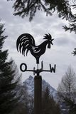 Swiss Weathercock. Weather vane with french directions stock photo