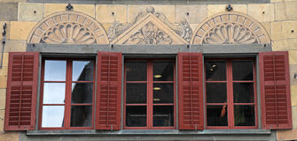 Swiss windows with brown shutters and mural painting Royalty Free Stock Photography