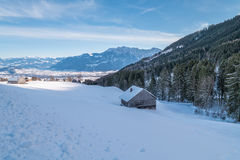 Swiss Winter - Barn covered in snow Stock Photography