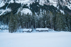 Swiss Winter - Barn under mountain stock images