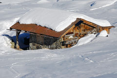 Swiss wooden chalet. A Swiss wooden chalet covered by snow Stock Photo