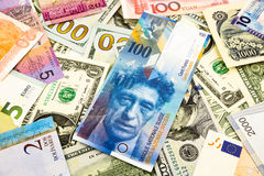 Swiss and world currency money banknote. Business and  financial concept Royalty Free Stock Images