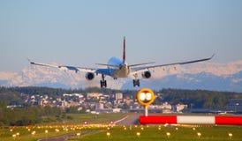 Swiss A-330. ZURICH - JULY 18: Swiss A-330 landing in Zurich airport after long haul flight on July 18, 2015 in Zurich, Switzerland. Zurich airport is home port Royalty Free Stock Photos