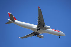 Swissair Airbus A330 in New York sky before landing at JFK Airport Stock Photo