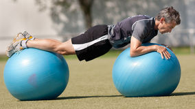 Swissball training. Athlete training on a swissball Royalty Free Stock Photo