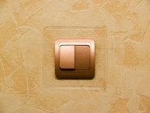 Switch. On-wall switch over orange wall Royalty Free Stock Photo