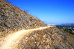Switch Back Trail. Narrow trail ascending the side of a hill, California Stock Image