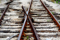 Switch at broken railroad tracks. Rusted and dilapidated railroad tracks with a track switch Royalty Free Stock Images