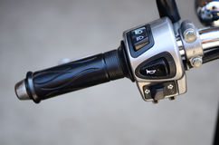 Switch control on a motorcycle handlebar Royalty Free Stock Images
