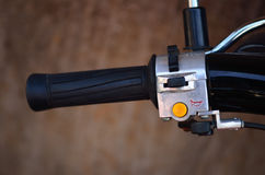 Switch control on a motorcycle handlebar Stock Photos