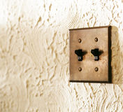Switch of the illumination of the wall of the room. Two illumination switches of the white wall of the room Royalty Free Stock Photos