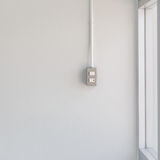 Switch light on white wall Royalty Free Stock Image