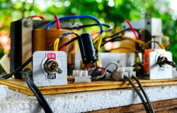 Switch On/Off of electric circuits. With green background royalty free stock photos