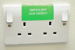 Save energy sign on plug sockets Royalty Free Stock Photos