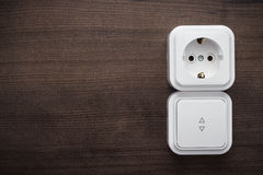 Switch and outlet on the wall Royalty Free Stock Image