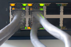Switch Ports online. A Ethernet Network Switch with power and link Stock Photo