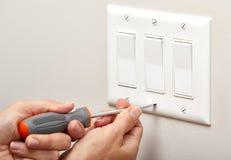 Switch repairing. Royalty Free Stock Image