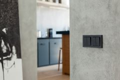 Switch and socket in the kitchen background. Stock Photos
