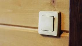 Switch on the wall. Turning off the light stock footage