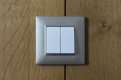 A light switch on the wooden wall Royalty Free Stock Photos