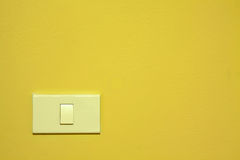 Switch on yellow wall Royalty Free Stock Photography