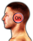 Switched On. Conceptual image of a man with a on button on his head Royalty Free Stock Photo