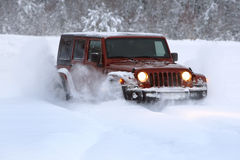 Off-road vehicle in snow. Stock Image