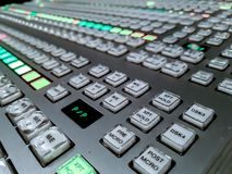 Switcher buttons in studio TV station. Switcher buttons in a studio TV station, be used when the TV show is on the air Stock Images