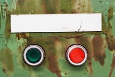 Switches with blank sign grunge. Detail of a broken control panel,paint splatter, knobs, blank sign free copy and picture space, on / off switches, free caption Royalty Free Stock Photos