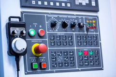 Switches on control panel of production machine Royalty Free Stock Photo