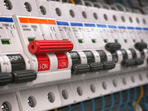 Switches in fusebox. Many black circuit breakers in a row Royalty Free Stock Photography