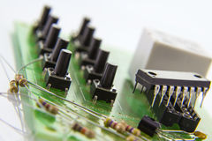 Switches on the motherboard with 10 local code lock. Switches on the motherboard with rezistors and 10 local code lock chip Stock Photos