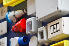 Switches and Sockets. Electrical colorful switches and sockets Stock Photo