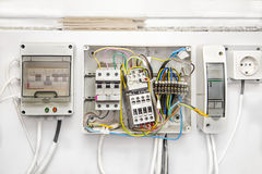 Switches, wires, breakers in boxes royalty free stock image